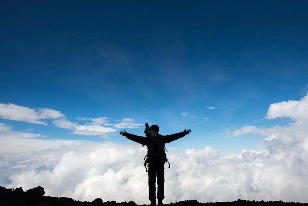 Hiker shadow on Summit of Mount Fuji,