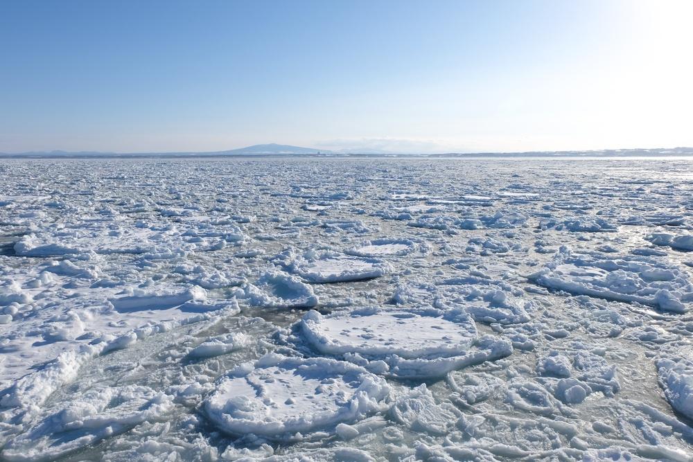 Drift Ice, Far mountain and blue Sky. Okhotsk Abashiri in winter