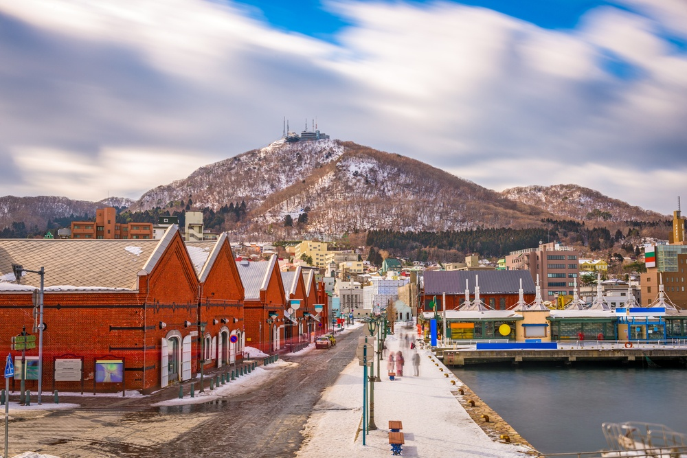 Hakodate, Japan cityscape at the historic Red Brick Warehouses and Mt. Hakodate