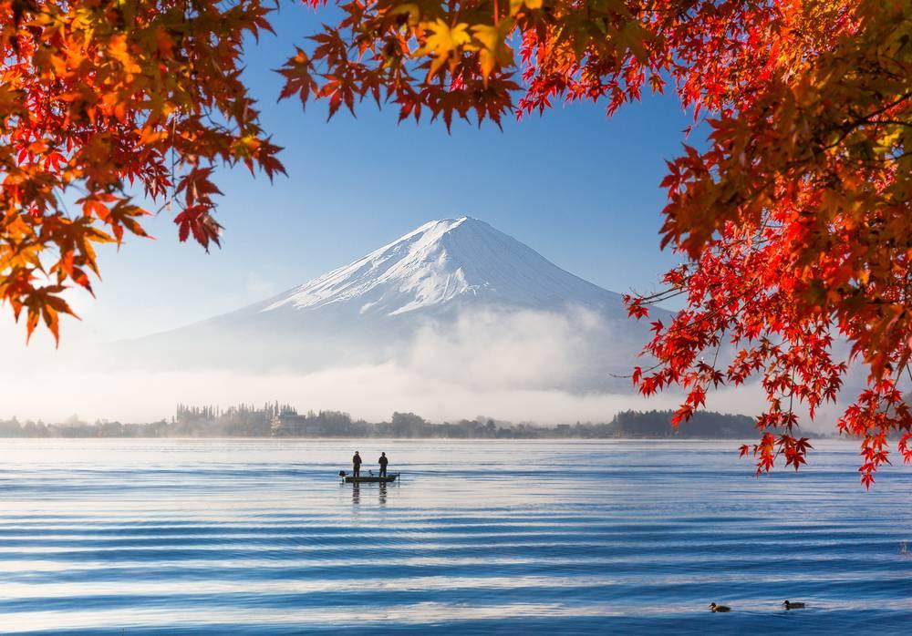 Autumn Season and Mountain Fuji with morning fog and red leaves at lake Kawaguchiko, Japan