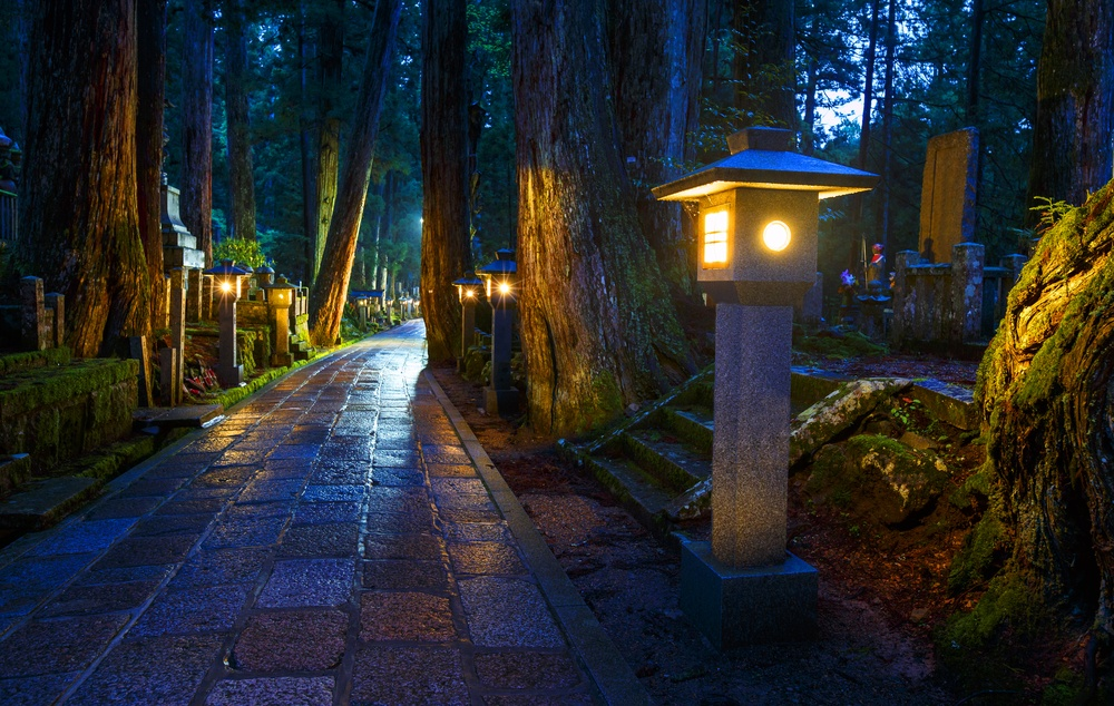 Buddhist ancient religious place hidden in the secret scary forest during the night - cemetery in Koyasan