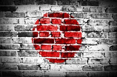 Japan flag painted on old brick wall