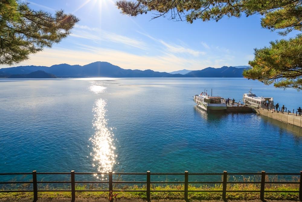 Passenger ships with sparkling sunshine in Lake Tazawa